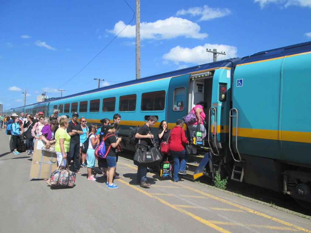 passengers boarding VIA Rail train at Moncton